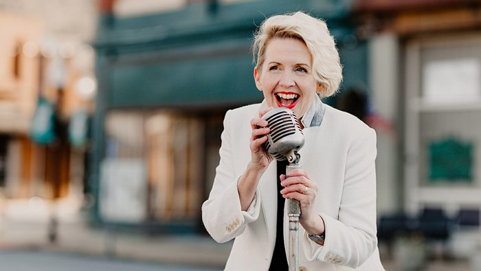 Lauretta Hannon with Microphone